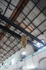 Colorful glass art hanging from beam at Dockyard Glassworks Bermuda.jpg
