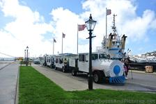 Bermuda Complimentary Train-like Tram Shuttle takes passengers from Cruise dock to Naval Dockyard & Clock Tower Mall.jpg