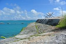 Fortified wall with view of ocean from Bermuda Royal Navy Dockyard.jpg