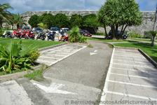 Motorcycles in parking lot of Bermuda Royal Naval Dockyard.jpg
