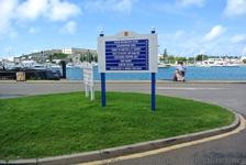 Signs posted at cruise ship docking area for Royal Naval Dockyard.jpg